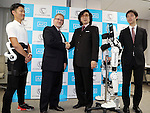 November 21, 2016, Tokyo, Japan - Japan's Tsukuba University professor and high-tech venture Cyberdyne president Yoshiyuki Sankai (2nd R) shakes hands with insurance company AIG Japan Holdings president Robert Noddin (2nd L) as they exchange documents on their agreement for business collaboration at a press conference at AIG Japan headquarters in Tokyo on Monday, November 21, 2016. AIG Japan will develop insurance products and related services using Cyberdyne's robot suit Hybrid Assistive Limb (HAL) and other technologies such as vital sensors.   (Photo by Yoshio Tsunoda/AFLO) LWX -ytd-