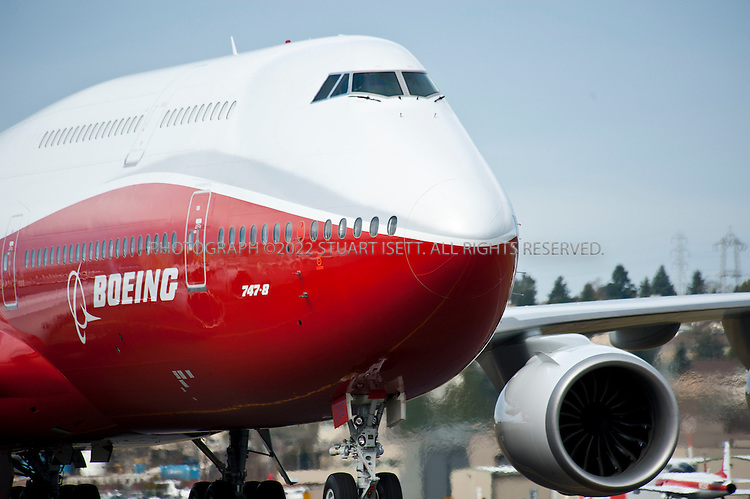 3/20/2011--Seattle, WA, USA..After the first successful test flight for Boeing's new 747-8 wide-body commercial jet airliner the airplane taxis at Boeing Field in Seattle. Officially announced in 2005, the 747-8 is the fourth-generation Boeing 747 version, with lengthened fuselage, redesigned wings and improved efficiency. The 747-8 is the largest 747 version, the largest commercial aircraft built in the United States, and the longest passenger aircraft in the world...The 747-8 is offered in two main variants: the 747-8 Intercontinental (747-8I) for passengers and the 747-8 Freighter (747-8F) for cargo...©2011 Stuart Isett. All rights reserved.