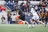 Annapolis, MD - February 11, 2017: Maryland Terrapins Austin Henningsen (18) wins the faceoff during game between Maryland vs Navy at  Navy-Marine Corps Memorial Stadium in Annapolis, MD.   (Photo by Elliott Brown/Media Images International)