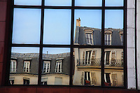 A typical reflected image on a mirror window in Paris. Digitally Improved Photo.