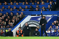 Chelsea Manager, Antonio Conte, makes a gesture from the touchline as Arsenal Manager, Arsene Wenger watches the match from the Press Box during Chelsea vs Arsenal, Caraboa Cup Football at Stamford Bridge on 10th January 2018