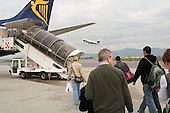Passengers walk to a Ryanair plane at Bergamo airport