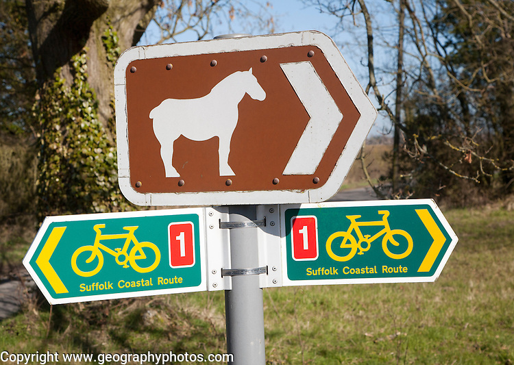 Sign for cycle route and pointing to Suffolk Punch horse tourist attraction of Easton Farm Park, at Hoo, Suffolk, England