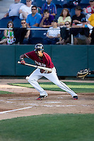 July 4, 2009: Yakima Bears' Roberto Rodriguez lays down a bunt during a Northwest League game against the Everett AquaSox at Everett Memorial Stadium in Everett, Washington.