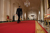 Washington, DC - February 9, 2009 -- United States President Barack Obama walks through the Cross Hall after conducting his first formal press conference in the East Room of the White House in Washington, D.C. on Monday, February 9, 2009..Credit: Ron Sachs / CNP..(RESTRICTION: No New York Metro or other Newspapers within a 75 mile radius of New York City)