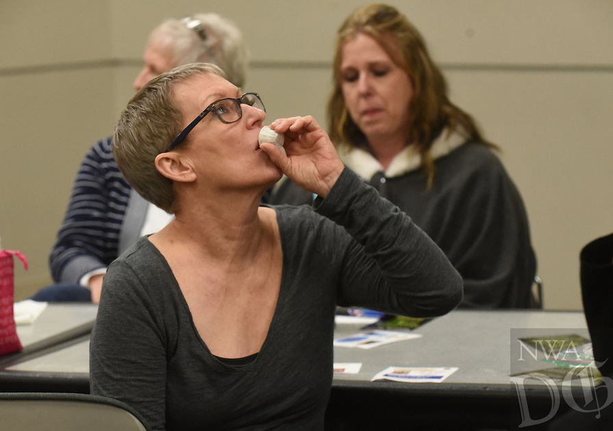 NWA Democrat-Gazette/FLIP PUTTHOFF <br /> TASTE TESTERS<br /> Lillie Juergens (cq) tastes a sample of balsamic vinegar on Tuesday Jan. 8 2019 during a Lunch and Learn program on cooking with olive oil and balsamic vinegar. Troy Johnson with Fresh Harvest in downtown Rogers and Eureka Springs provided samples of olive oils and vinegars for patrons to taste and explained the uses of each. Lunch and learn is held from noon to 1 p.m. on the second Tuesday of each month at the library, The next program on Feb. 12 will preview the exhibit, &quot;Men of Steel, Women of Wonder,&quot; coming to Crystal Bridges Museum of American Art. Alejo Benedetti, assistant curator, is the presenter.