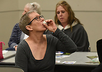 """NWA Democrat-Gazette/FLIP PUTTHOFF <br /> TASTE TESTERS<br /> Lillie Juergens (cq) tastes a sample of balsamic vinegar on Tuesday Jan. 8 2019 during a Lunch and Learn program on cooking with olive oil and balsamic vinegar. Troy Johnson with Fresh Harvest in downtown Rogers and Eureka Springs provided samples of olive oils and vinegars for patrons to taste and explained the uses of each. Lunch and learn is held from noon to 1 p.m. on the second Tuesday of each month at the library, The next program on Feb. 12 will preview the exhibit, """"Men of Steel, Women of Wonder,"""" coming to Crystal Bridges Museum of American Art. Alejo Benedetti, assistant curator, is the presenter."""