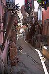 Narrow alley in metal work part of the medina, Marrakech, Morocco
