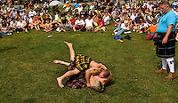 Men wrestle during the Scottish Athletic events during the 52nd Annual Grandfather Mountain Highland Games in Linville, NC.