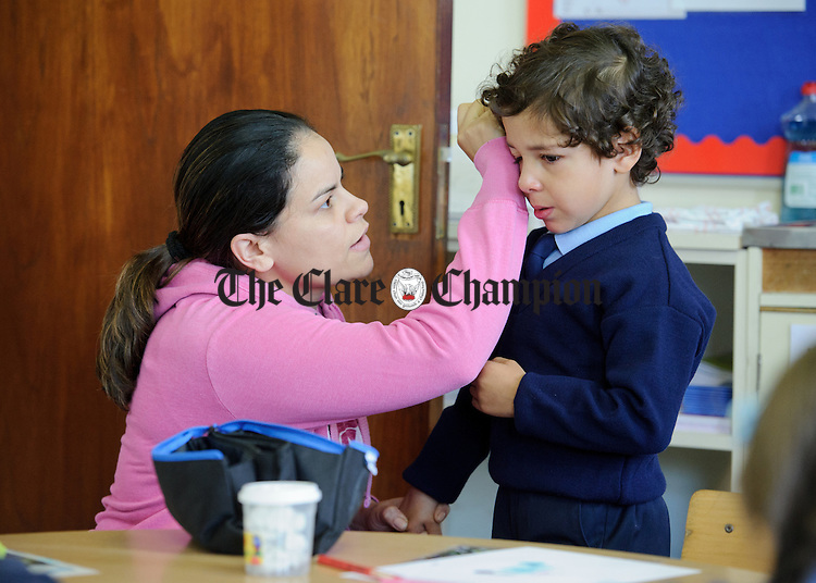 Marta Noleto da Silva comforts little Nickolas Dias  on his first day of school at Boston NS. Photograph by John Kelly.