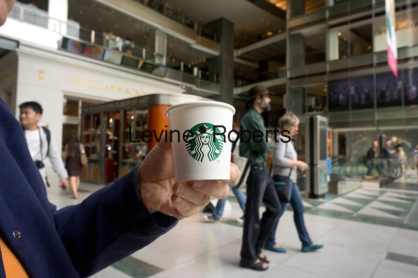 A single up serving of espresso from a newly introduced Starbucks brand single-shot espresso coffee brewer from a demonstration at a Williams-Sonoma store in New York on Saturday, September 22, 2012. The single-cup machines, called Verismo, which use a their own proprietary coffee pod, are in direct competition with Green Mountain Roasters, using Keurig pods,  which controls a 90% share of the US market. The Starbucks machines are specifically for single shots of espresso, lattes and espresso style drinks. (© Richard B. Levine)