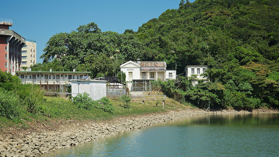 The Watchman's Cottage Stands Guard Over The Pok Fu Lam Reservoir Dam Wall, Hong Kong Island.
