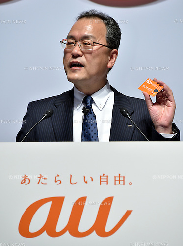 May 8, 2014, Tokyo, Japan - President Koji Tanaka of KDDI introduces au Wallet, a plastic electronic money, as the nation's second largest communications carrier launches a new lineup of its smartphones and tablet computers for 2014 summer in Tokyo on Thursday, May 8, 2014.  (Photo by Natsuki Sakai/AFLO)