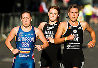 30 JUN 2011 - LONDON, GBR - Jodie Stimpson, Lucy Hall, Hollie Avil push each other on during the women's super sprint eliminator at the  GE Canary Wharf Triathlon (PHOTO (C) NIGEL FARROW)