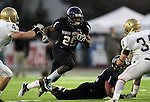 ROME, GA - DECEMBER 18: Chevon Walker #29 of the University of Sioux Falls looks for running room between Noah McWilliams #42 and Brian Strobel #34 of Carroll College in the second quarter at Barron Stadium in the 2010 NAIA National Football Championship in Rome, GA.(photo by Dave Eggen/Inertia)