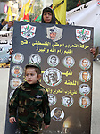 Palestinians take part during a rally marking the 54th anniversary of Fatah's founding, in the West Bank city of Ramallah, on December 31, 2018. Photo by Ahmad Arouri