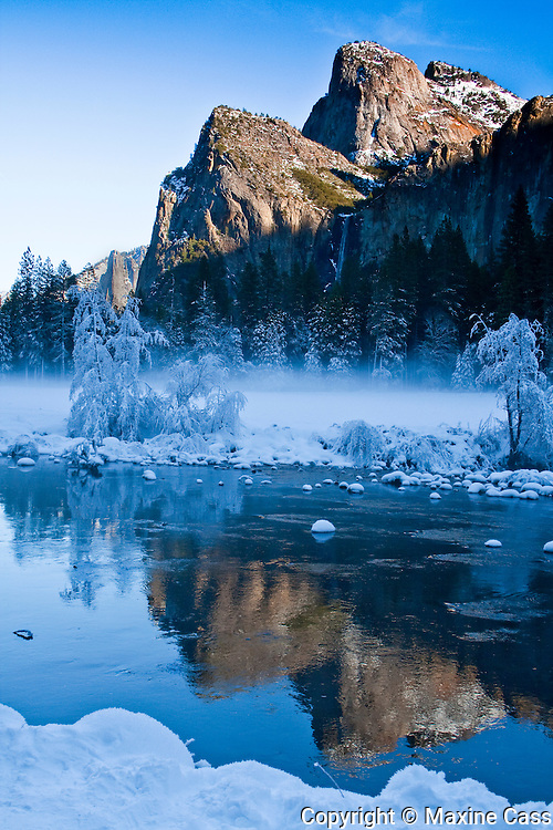 Yosemite National Park Valley View vista of Cathedral Rocks reflected in the Merced River in Winter, California, United States of America