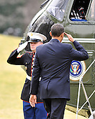 Washington, D.C. - March 6, 2009 -- United States President Barack Obama salutes the Marine Guard as he boards Marine One to depart the South Lawn of the White House in Washington, D.C. on Friday, March 6, 2009 to make remarks at the Columbus (Ohio) Police Graduation Exercise later in the morning..Credit: Ron Sachs / Pool via CNP