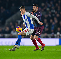 Arsenal's Sead Kolasinac (right) battles with Brighton & Hove Albion's Solly March (left) <br /> <br /> Photographer David Horton/CameraSport<br /> <br /> The Premier League - Brighton and Hove Albion v Arsenal - Wednesday 26th December 2018 - The Amex Stadium - Brighton<br /> <br /> World Copyright © 2018 CameraSport. All rights reserved. 43 Linden Ave. Countesthorpe. Leicester. England. LE8 5PG - Tel: +44 (0) 116 277 4147 - admin@camerasport.com - www.camerasport.com