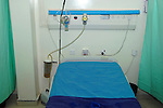 Above the bed are bed-head oxygen and medical gases outlets (from a piped gas system). There is also an oxygen mask and other equipment used during the routine care and monitoring of patients. Humidifying chambers allow humidified gases to be given, if necessary. Finally, various sockets and light switches aid the patient's comfort. The bed is separated from Royalty Free