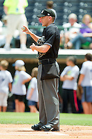 Home plate umpire Jon Byrne throws a ball to the pitcher's mound prior to the start of the International League game between the Louisville Bats and the Charlotte Knights at Knights Stadium on July 17, 2011 in Fort Mill, South Carolina.  The Knights defeated the Bats 7-6.   (Brian Westerholt / Four Seam Images)