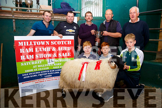 John O'Sullivan Chairman Milltown Mart presenting the Cup for Show Champion Scotch Lamb to James Clifford from Cahersiveen, pictured front l-r; Jack Griffin, Kevin Griffin, Jack Clifford, back l-r; Dan McCarthy(Secretary), Paudie O'Sullivan(Treasurer), John O'Sullivan, James Clifford, & Pat Deane(Judge).