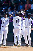 Courtney Hawkins (10) of the Winston-Salem Dash is greeted at home plate by teammates Keon Barnum (20) and Tim Anderson (7) after hitting a 3-run home run against the Salem Red Sox at BB&T Ballpark on April 20, 2014 in Winston-Salem, North Carolina.  The Dash defeated the Red Sox 10-8.  (Brian Westerholt/Four Seam Images)