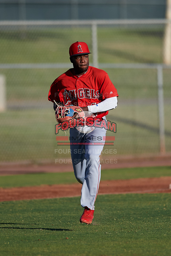AZL Angels third baseman Julio De La Cruz (44) prepares to make a throw to first base during an Arizona League game against the AZL Giants Black at the Giants Baseball Complex on June 21, 2019 in Scottsdale, Arizona. AZL Angels defeated AZL Giants Black 6-3. (Zachary Lucy/Four Seam Images)