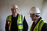 © Joel Goodman - 07973 332324 .  04/02/2014 . Manchester , UK . L-R Ed Balls and Mike Kane . Ed Balls , MP for Morley and Outwood and Shadow Chancellor of the Exchequer the Labour Party , joins Labour candidate Mike Kane on the campaign trail ahead of the Wythenshawe and Sale East by-election , following the death of MP Paul Goggins . They visit apprentices at the Leybrook Road building site in Wythenshawe where apprentice builders work on bungalows built for affordable rent . Photo credit : Joel Goodman