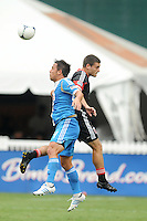Philadelphia Union forward Danny Cruz (44) heads the ball from D.C. United defender Chris Korb (22) D.C. United tied The Philadelphia Union 1-1 at RFK Stadium, Saturday August 19, 2012.
