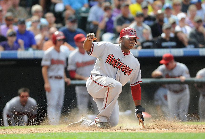 05 SEPTEMBER 2011:  Diamondbacks right fielder Justin Upton (10) is safe at home  during a regular season game between the Arizona Diamondbacks and and the Colorado Rockies at Coors Field in Denver, Colorado.  The Diamondbacks beat the Rockies 10-7.  *****For Editorial Use Only*****