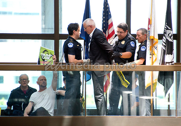"United States Capitol Police arrest protestors chanting ""Healthcare is a right"" outside the office of United States Senator Lisa Murkowski (Republican of Alaska) in the Hart Senate Office Building in Washington, DC on Wednesday, June 28, 2017. Photo Credit: Ron Sachs/CNP/AdMedia"