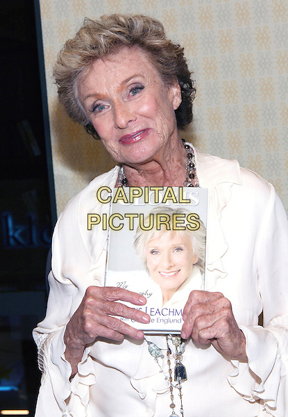 CLORIS LEACHMAN .bookstore appearance signing her autobiography 'Cloris' held at Barnes & Noble at The Grove, Los Angeles, CA, USA, 7th April 2009..half length white cream ruffle sleeved blouse shirt holding book .CAP/ADM/TC.©T. Conrad//Admedia/Capital Pictures
