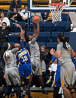 Afure Jemerigbe of California rebounds the ball during the game against Bakersfield at Haas Pavilion in Berkeley, California on December 15th, 2013.  California defeated Bakersfield Roadrunners, 70-51.