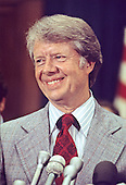 Governor Jimmy Carter (Democrat of Georgia), a candidate for the 1976 Democratic nomination for President of the United States, speaks before US House members and employees in the Rayburn House Office Building in Washington, DC on May 15, 1976.<br /> Credit: Arnie Sachs / CNP