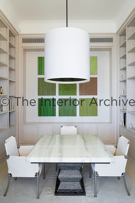 The informal dining space is of a classic contemporary design scheme, which emphasizes pale muted colours and simple architectural forms.