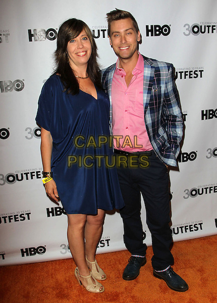 Kirsten Schaffer, Lance Bass.The 2012 Outfest Opening Night Gala of Vito Held at The Orpheum Theatre, Los Angeles, California, USA..July 12th, 2012.full length black trousers pink shirt blue check suit jacket plaid tartan dress.CAP/ADM/KB.©Kevan Brooks/AdMedia/Capital Pictures.