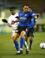 24 March 2004:  Earthquakes' Ramiro Corrales dribbles the ball away from LD Alajuelense's Steven Bryce during the CONCACAF Champions Cup at Spartan Stadium in San Jose, California.   San Jose won the game, final score: 1-0.