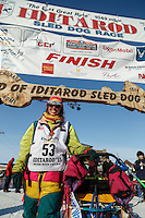 Monica Zappa poses for a photo at the finish line in Nome on Saturday March 21, 2015 during Iditarod 2015.  <br /> <br /> (C) Jeff Schultz/SchultzPhoto.com - ALL RIGHTS RESERVED<br />  DUPLICATION  PROHIBITED  WITHOUT  PERMISSION