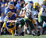 BROOKINGS, SD - SEPTEMBER 28:   Doug Peete #34 from South Dakota State University wraps up Sam Ojuri #22 from North Dakota State University in the third quarter of their game Saturday afternoon at Coughlin Alumni Stadium in Brookings. (Photo by Dave Eggen/Inertia)