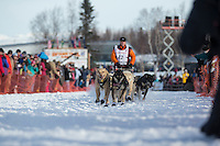 Linwood Fiedler runs down the chute on Willow Lake after leaving the re-start chute in Willow, Alaska at the restart of the Iditarod sled dog race Sunday, March 3, 2013.