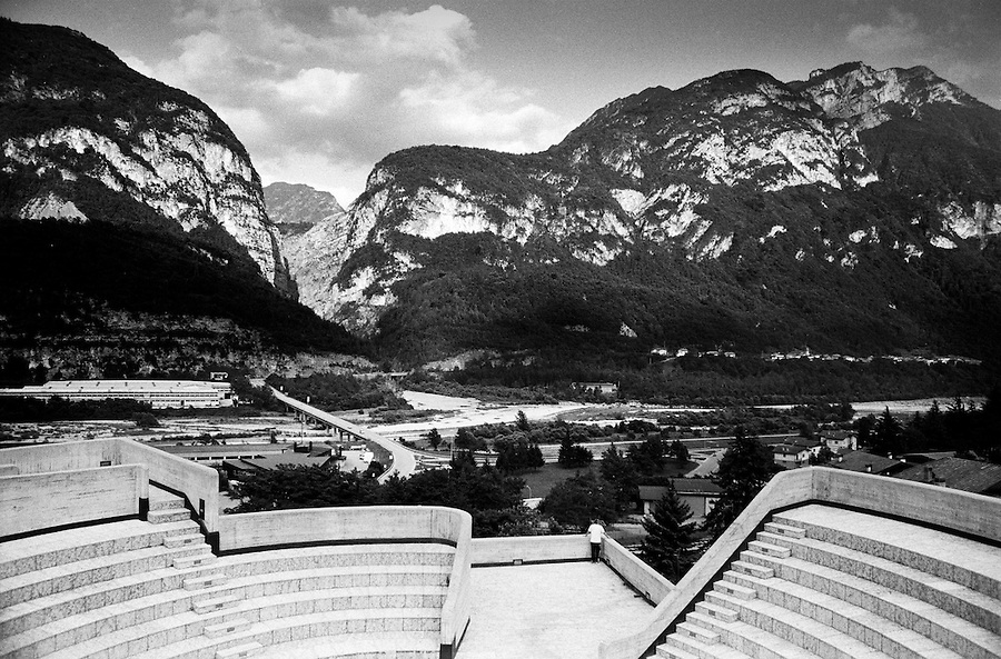 View towards the gorge and the dam as seen from the chuch rooftop in Longarone. On October 9th 1963 a giant landslide collapses into the artificial lake created by the Vajont Dam in northern Italy, provoking a 250 meters high wave that completely destroys the settlements near the lake and the town of Longarone far down in the valley below the dam. 1910 people lost their lives in a tragedy that easily could have been avoided if it was not for the economical and political interests of powerful men dreaming of the tallest dam in the world. A tragedy that is still alive today in Erto, Casso and Longarone, where the survivers of that disastrous day almost 50 years ago are still fighting for their justice.