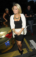 Sam Faiers.attended the Kensington Club new boutique nightclub launch party, The Kensington Club, High Street Kensington, London, England,.20th July 2012..full length white jacket back dress clutch bag .CAP/CAN.©Can Nguyen/Capital Pictures.