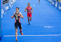 31 MAY 2014 - LONDON, GBR - Jonathan Brownlee (GBR) (left) of Great Britain takes 5th place ahead of 2013 World Champion Javier Gomez (ESP) (right) of Spain during the men's 2014 ITU World Triathlon Series round in Hyde Park in London, Great Britain (PHOTO COPYRIGHT © 2014 NIGEL FARROW, ALL RIGHTS RESERVED)