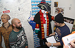 Nicholas Christopher and Lin-Manuel Miranda during the cast of 'Hamilton' 2016 Door Decorating Competition at Richard Rodgers Theatre on December 23, 2016 in New York City.
