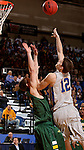 BROOKINGS, SD - FEBRUARY 14:  Keaton Moffitt #12 from South Dakota State shoots a short hook shot over Paul Miller #2 form North Dakota State in the first half of their game Saturday afternoon at Frost Arena. (Photo by Dave Eggen/Inertia)
