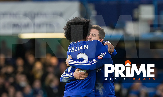 Willian of Chelsea celebrates with goal scorer Eden Hazard of Chelsea during the FA Cup 5th round match between Chelsea and Manchester City at Stamford Bridge, London, England on 21 February 2016. Photo by Andy Rowland.