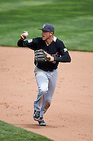 New Britain Rock Cats shortstop Trevor Story (4) checks the runner on third during a run down during a game against the Akron RubberDucks on May 21, 2015 at Canal Park in Akron, Ohio.  Akron defeated New Britain 4-2.  (Mike Janes/Four Seam Images)