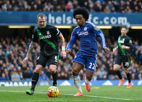 05.03.2016. Stamford Bridge, London, England. Barclays Premier League. Chelsea versus Stoke City. Chelsea Midfielder Willian attacks the Stoke are, as Stoke City Midfielder Glenn Whelan challenges