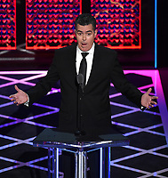 "BEVERLY HILLS - SEPTEMBER 7: Adam Carolla appears onstage at the ""Comedy Central Roast of Alec Baldwin"" at the Saban Theatre on September 7, 2019 in Beverly Hills, California. (Photo by Frank Micelotta/PictureGroup)"